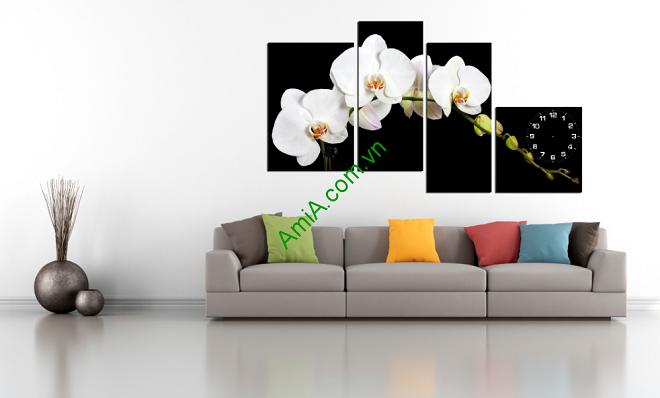 Treo tranh hoa phong lan trang tong nen den o phong khach dep lai sang trong